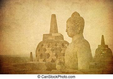 Vintage image of Buddha statue at Borobudur temple, Java,...