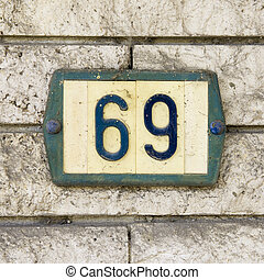 Nr.69 - house number sixty-nine on a plastic number shield