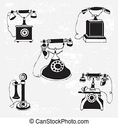 set of vintage phones on pattern background