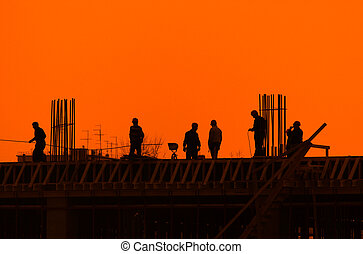 Builders on a construction site for a new building