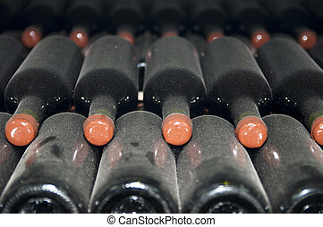 cellars with wine bottles - wine bottles stored in the old...