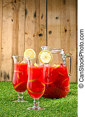 Chilled Orange Lemon Sangria in a summer setting - Chilled...