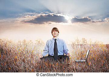 Businessman meditating in lotus pose Business yoga