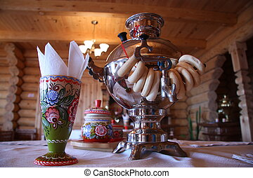 Russian tea drinking with samovar and bread rolls in a...