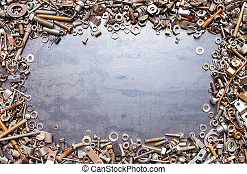 assorted nuts and bolts frame on metal texture background
