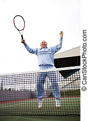 Senior tennis player - An asian senior tennis player jumping...