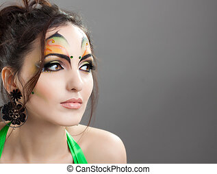 Cute girl with proffesional make up looking somewhere