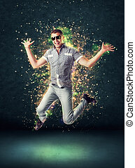 Jumping smiling young man on glowing abstract background