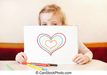 little girl holding album with hearts. Valentine's Day