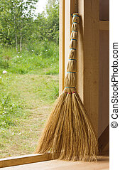 Besom in doorway of wooden country house - Straw besom...