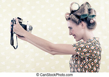 Woman taking Self-portrait - Woman taking self-portrait from...