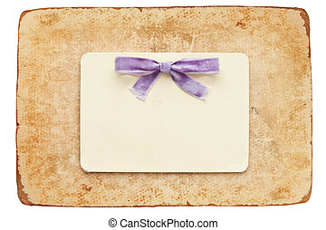vintage card with lilac bow isolated on white background