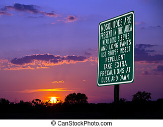 Mosquitoes warning sign against beautiful evening sky