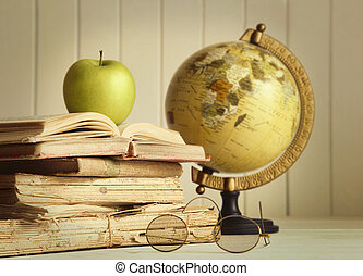 Old books with apple