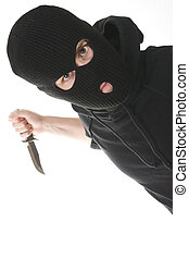 criminal - evil criminal wearing balaclava with a knife