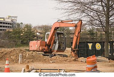 Orange Loader in Dirt - An orange front end loader in dirt...