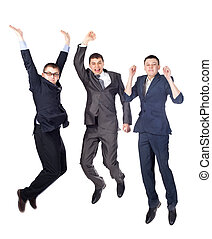 Three young business men jumping isolated on white...