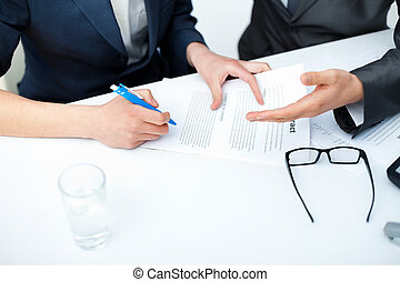 Close up of businessman's hands signing a contract