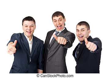Three young business men laughing and giving the thumbs up...