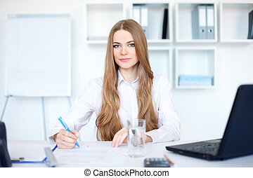 Portrait of a beautiful young business woman in the office...