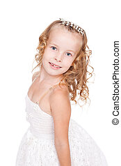 pretty little girl in beautiful white dress isolated on...