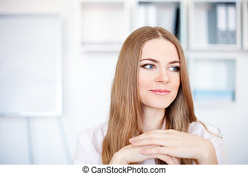 Portrait of a beautiful young business woman working in bright office