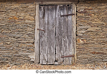 Stone wall with old door