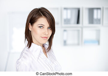 Closeup portrait of beautiful young business woman at office