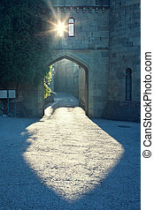 Mysterious urban scene - Light falling through an arch and...