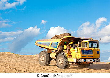 Tip truck at a construction site - A tip truck with sand or...