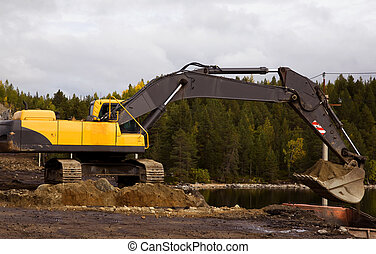 Yellow excavator digging - Crawler excavator working on the...