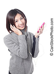 Young Happy Girl listen music with earphones by smart phone...