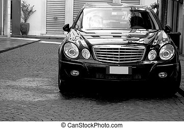 Black Luxury Vehicle - A luxury vehicle in Florence, Italy.