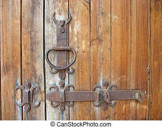 Ancient wooden door rustic metallic detail