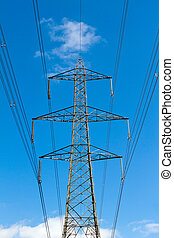electricity pylon with blue sky background