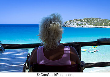 Woman in Relax , Voulisma beach Crete Greece