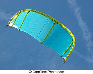 kitesurfing - blue and green kite for kitesurfing in the sky