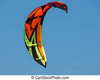 kitesurfing - kite for kitesurfing on the blue sky