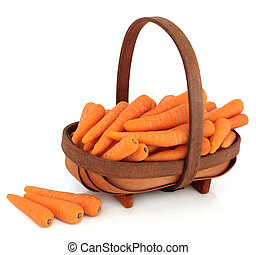 Carrots in a Basket - Carrot vegetables in a rustic wooden...