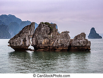 Vietnam Halong Bay: The Kissing Rocks under sunset foggy...