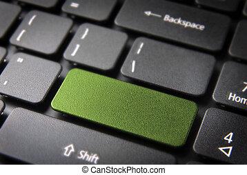 Green keyboard key - Green key on laptop keyboard with blank...