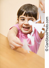 children - little girl playing with paper dolls