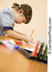 children - little girl playing with colors Copy space at the...