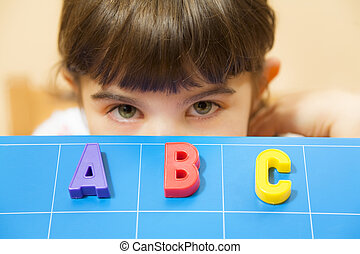 children - child learning the ABC\\\'s. The focus is on the...