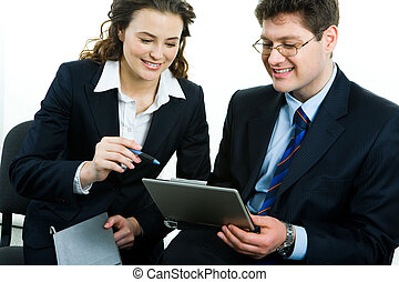 Teamwork - Portrait of two business people discussing a new...