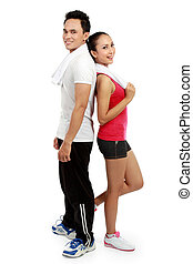 Fitness Smiling young man and woman - portrait of Fitness....