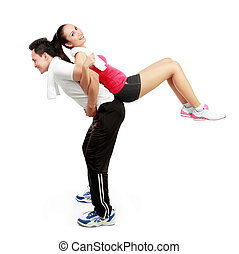 warming up - Portrait of sporty healthy young woman and man...