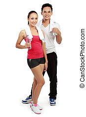 man and woman with water after workout - Smiling young man...