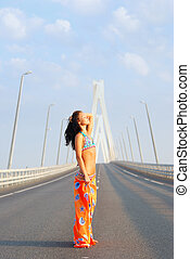 Young woman relax on bridge
