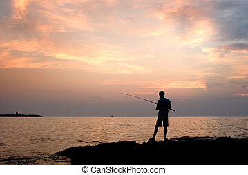 The lonely fisherman - The person fishes A sea landscape The...